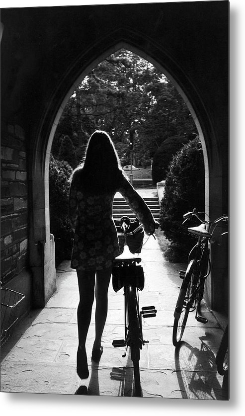 Arch Metal Print featuring the photograph Silhouette Of College Co-ed Walking Her by Alfred Eisenstaedt