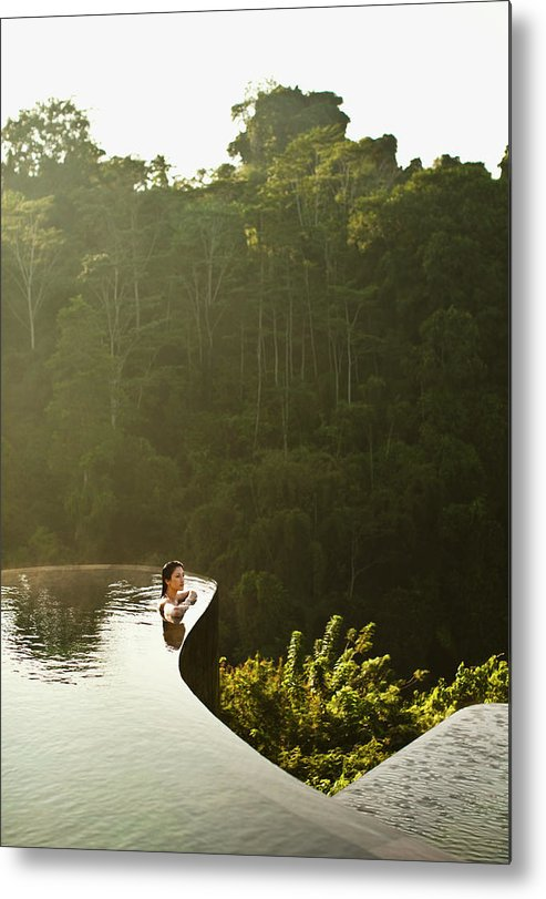 Tropical Rainforest Metal Print featuring the photograph Woman In Infinity Pool At Sunrise. Bali by Matthew Wakem