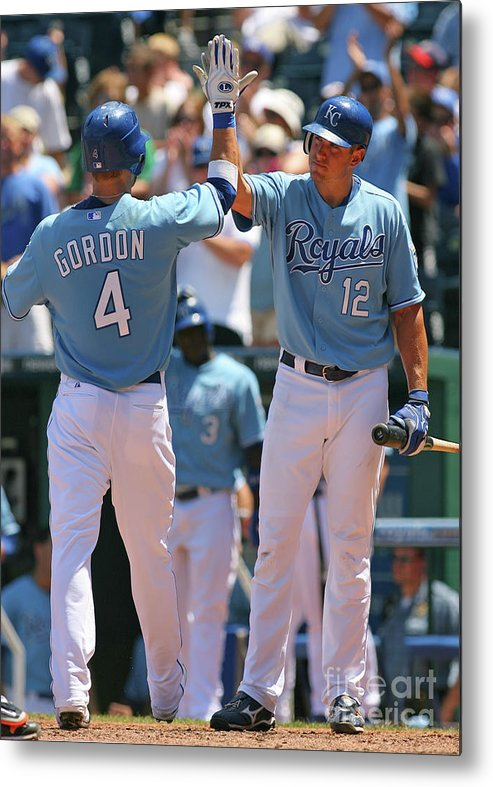 American League Baseball Metal Print featuring the photograph Alex Gordon and Mitch Maier by Tim Umphrey