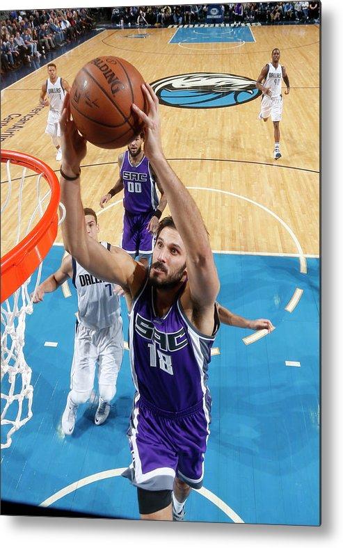 Nba Pro Basketball Metal Print featuring the photograph Omri Casspi by Glenn James