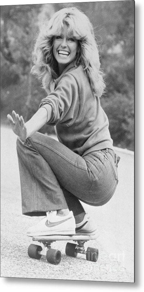Charlie's Angels Metal Print featuring the photograph Farrah Fawcett Riding Skateboard by Bettmann