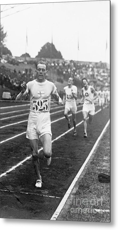 The Olympic Games Metal Print featuring the photograph Paavo Nurmi Winning Olympic Track Race by Bettmann