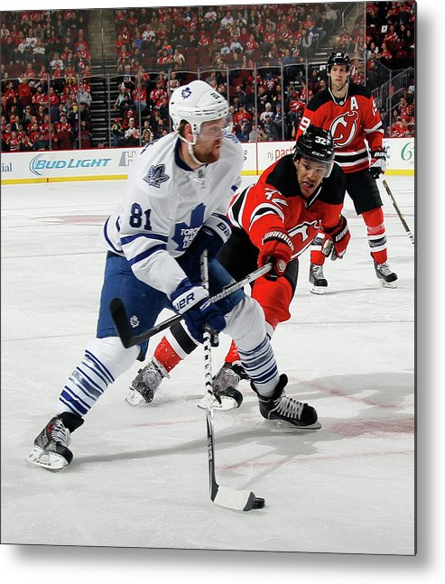 National Hockey League Metal Print featuring the photograph Toronto Maple Leafs V New Jersey Devils by Bruce Bennett