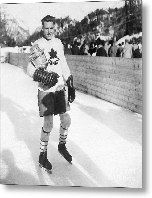 The Olympic Games Metal Print featuring the photograph Canadian Hockey Captain With Olympic by Bettmann
