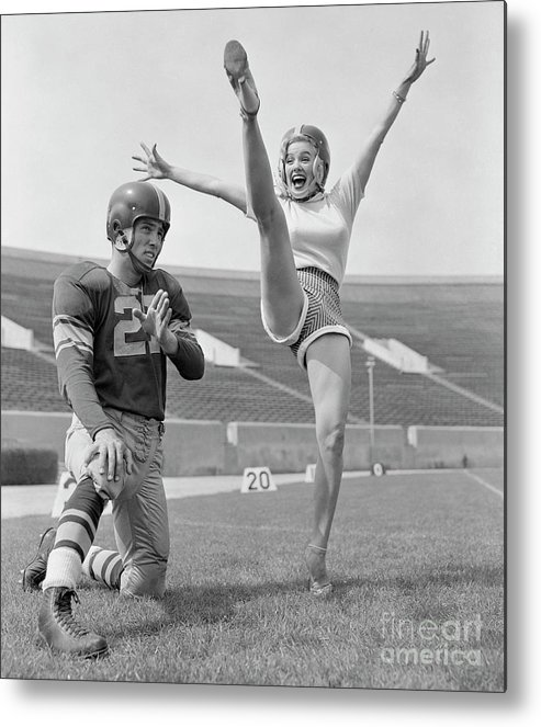 American Football Uniform Metal Print featuring the photograph Mamie Van Doren Kicking On Football by Bettmann