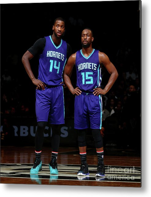 Kemba Walker Metal Print featuring the photograph Kemba Walker and Michael Kidd-gilchrist by Nathaniel S. Butler