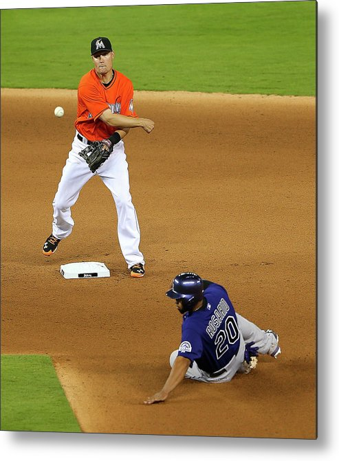 Double Play Metal Print featuring the photograph Wilin Rosario by Mike Ehrmann