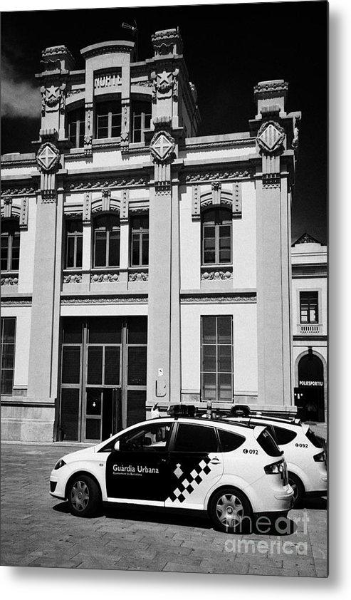 Policia Metal Print featuring the photograph policia guardia urbana patrol cars outside estacio del nord station Barcelona Catalonia Spain by Joe Fox