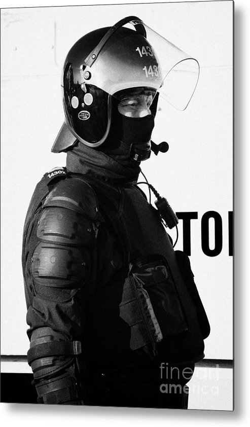 Northern Metal Print featuring the photograph Psni Officer In Ninja Riot Geat On Crumlin Road At Ardoyne Shops Belfast 12th July by Joe Fox
