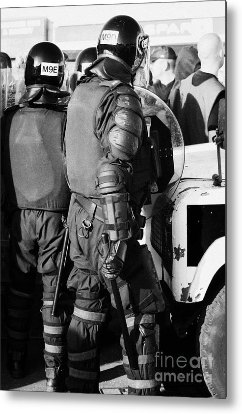 Northern Metal Print featuring the photograph Psni Officer In Riot Gear With Shield And Baton On Crumlin Road At Ardoyne Shops Belfast 12th July by Joe Fox
