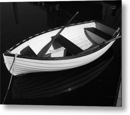 Boats Metal Print featuring the photograph A White Rowboat by Xueling Zou