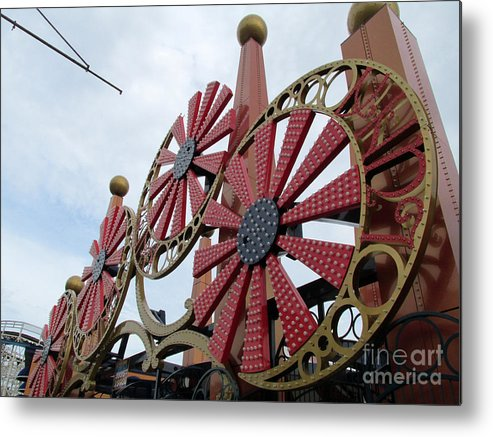 Swirls Metal Print featuring the photograph Arcade Wheels by Lynellen Nielsen