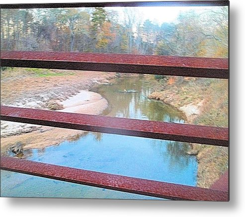 River Metal Print featuring the photograph The River Through The Rails by James Potts