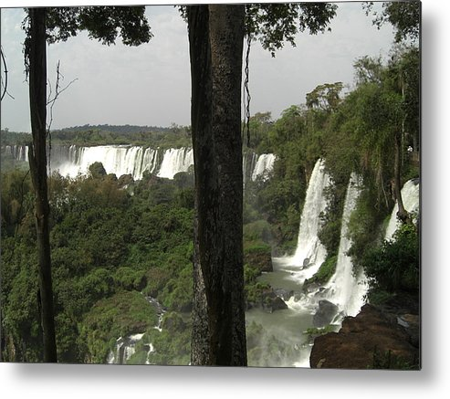 A Photo Taken Through The Woodland Forest Looking Out To Iguassu Falls On The Argentina Side. Metal Print featuring the photograph Woods Of Iguassu Falls by Paul Jessop