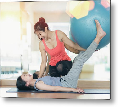 Trainer Metal Print featuring the photograph Asian Woman Fitness Coach Teach Her Student For Rubber Ball Exer by Anek Suwannaphoom