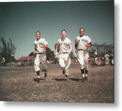 American League Baseball Metal Print featuring the photograph Yankees Outfield by Hulton Archive
