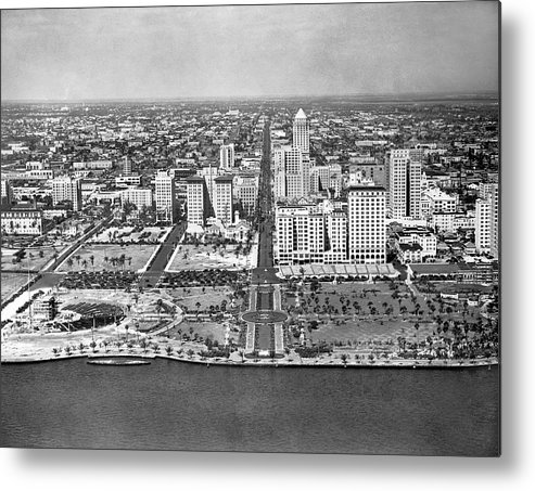 1920s Metal Print featuring the photograph Looking Up Flagler Street At Downtown Miami by Underwood Archives
