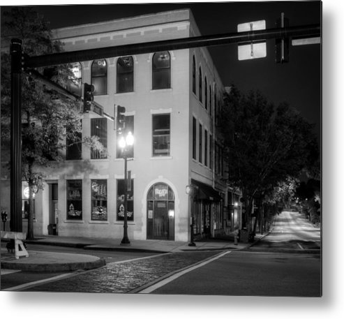 Front Street Metal Print featuring the photograph Distant Light On Front Street In Black And White by Greg Mimbs