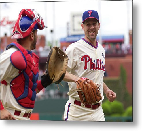 Baseball Catcher Metal Print featuring the photograph Cliff Lee And Wil Nieves by Mitchell Leff