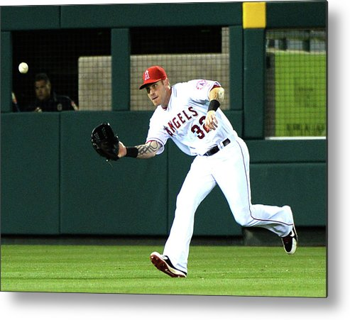American League Baseball Metal Print featuring the photograph Josh Hamilton And Dustin Ackley by Harry How