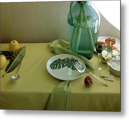 Table Setting Metal Print featuring the photograph Plates, Apples And A Vase On A Green Tablecloth by Horst P. Horst