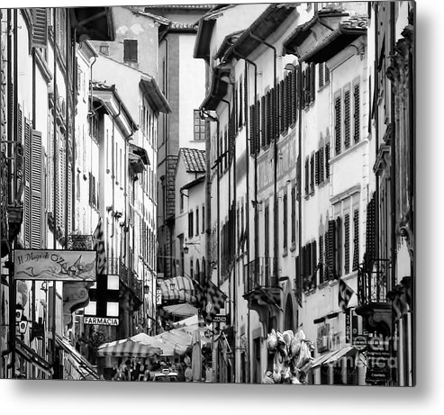 Italian Village Metal Print featuring the photograph Restless In Arezzo-italy by Jennie Breeze