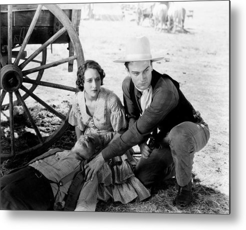 1930s Movies Metal Print featuring the photograph The Big Stampede, Kneeling, From Left by Everett