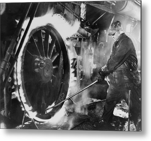 History Metal Print featuring the photograph Railroad Worker Sweating A Tire by Everett