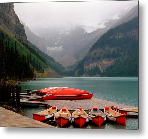 Lake Louise Metal Print featuring the photograph Nestled Boat Launch by Diane Wallace