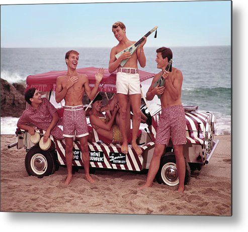 Child Metal Print featuring the photograph Guys And Gals On The Beach by Tom Kelley Archive