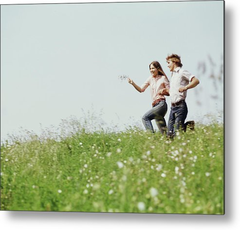 Photography Metal Print featuring the photograph 1970s Boy Girl Running Field by Vintage Images