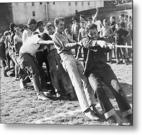 1940s Metal Print featuring the photograph Kids Have Tug Of War Battle by Underwood Archives