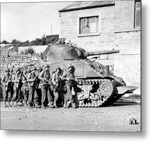 Horizontal Metal Print featuring the photograph Soldiers And Their Tank Advance by Stocktrek Images