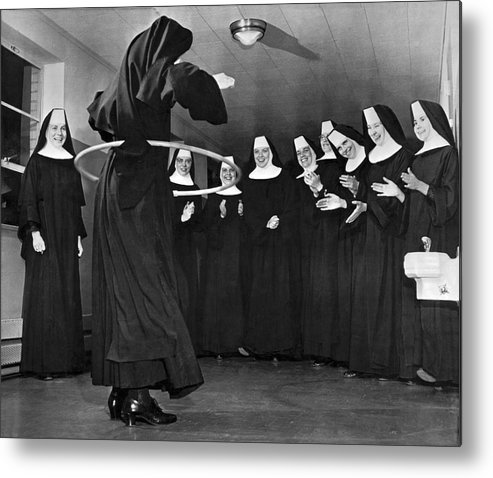 1958 Metal Print featuring the photograph Nun Swivels Hula Hoop On Hips by Underwood Archives