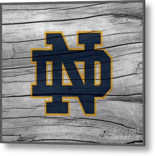 Football Metal Print featuring the photograph University Of Notre Dame Fighting Irish Logo On Rustic Wood by John Stephens