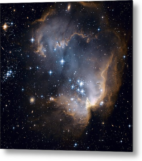 Galaxy Metal Print featuring the photograph Bright Blue Newborn Stars Blast A Hole by ESA and nASA
