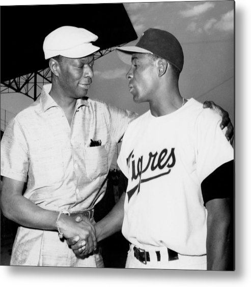 1950-1959 Metal Print featuring the photograph Nat King Cole And Minnie Minoso by Michael Ochs Archives