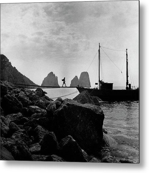 Capri Metal Print featuring the photograph A Boat Docked At Capri by Clifford Coffin