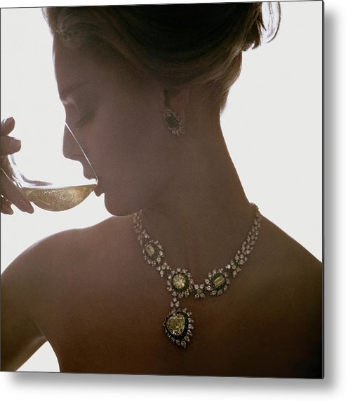 Jewelry Metal Print featuring the photograph Close Up Of A Young Woman Wearing Jewelry by Bert Stern