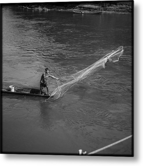 Fisherman Metal Print featuring the photograph Fisherman In Luang Prabang by Luca Sartor