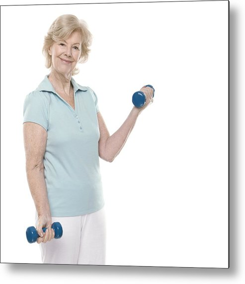 60s Metal Print featuring the photograph Senior Woman Lifting Weights by