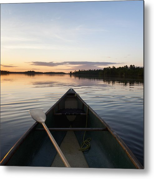 Beauty In Nature Metal Print featuring the photograph A Boat And Paddle On A Tranquil Lake by Keith Levit