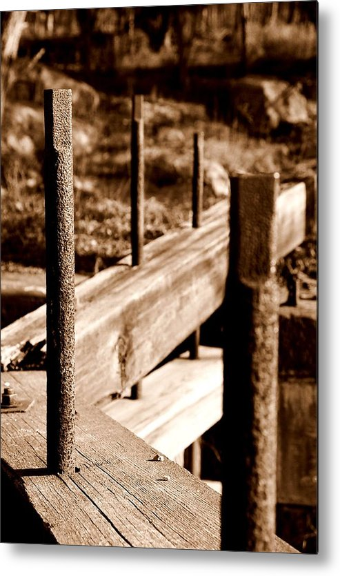 Wood Metal Print featuring the photograph Rust And Wood by Caroline Clark