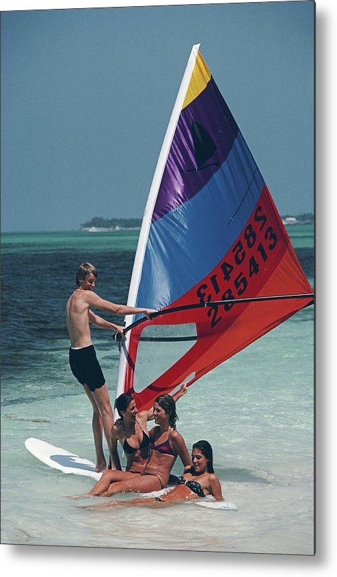 Young Men Metal Print featuring the photograph Bahamas Windsurfing by Slim Aarons