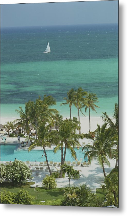 Swimming Pool Metal Print featuring the photograph Freeport Beach by Slim Aarons