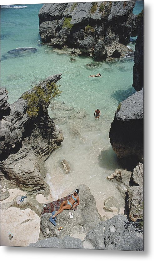 People Metal Print featuring the photograph On The Beach In Bermuda by Slim Aarons