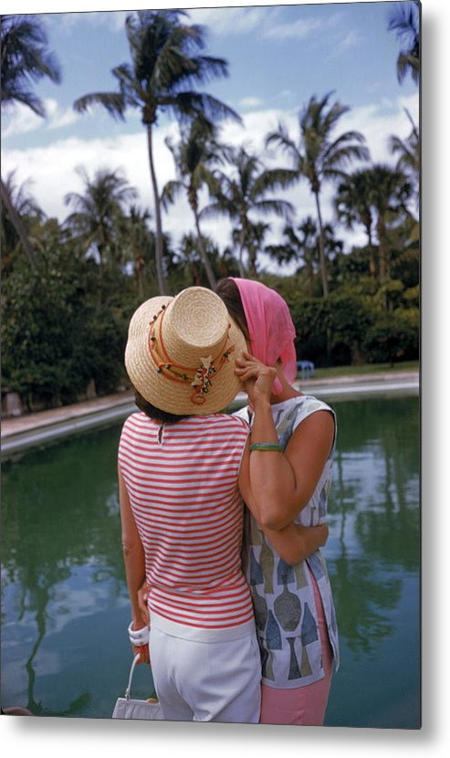 Lilly Pulitzer Metal Print featuring the photograph Poolside Secrets by Slim Aarons