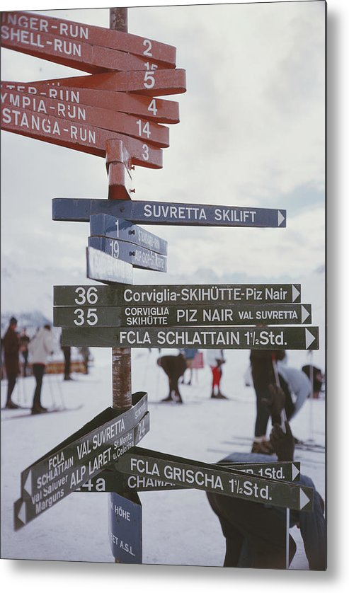 People Metal Print featuring the photograph Signpost In St. Moritz by Slim Aarons