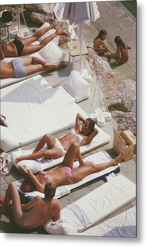 Recreational Pursuit Metal Print featuring the photograph Sunbathers At Eden Roc by Slim Aarons