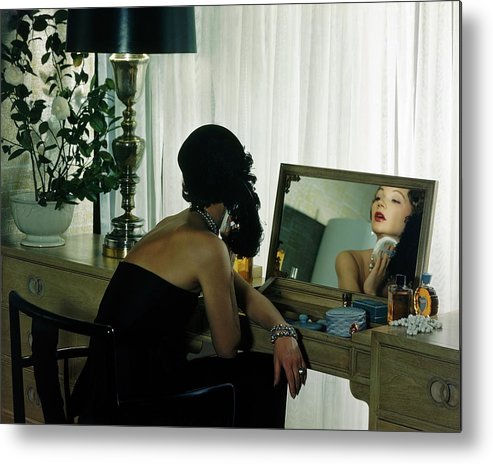 Model Metal Print featuring the photograph A Model Getting Ready In A Mirror by Herbert Matter
